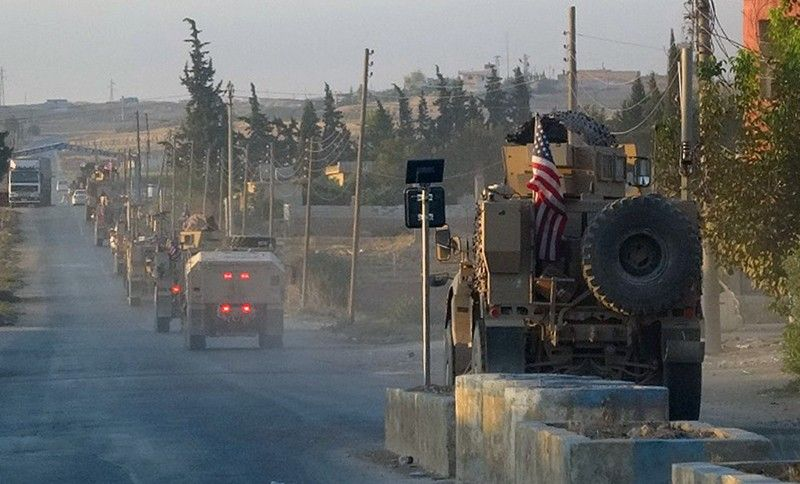 SYRIA. In this image provided by Hawar News Agency, ANHA, U.S. military vehicles travel down a main road in northeast Syria, Monday, October 7, 2019. U.S.-backed Kurdish-led forces in Syria said American troops began withdrawing Monday from their positions along Turkey's border in northeastern Syria, ahead of an anticipated Turkish invasion that the Kurds say will overturn five years of achievements in the battle against the Islamic State group. (AP)
