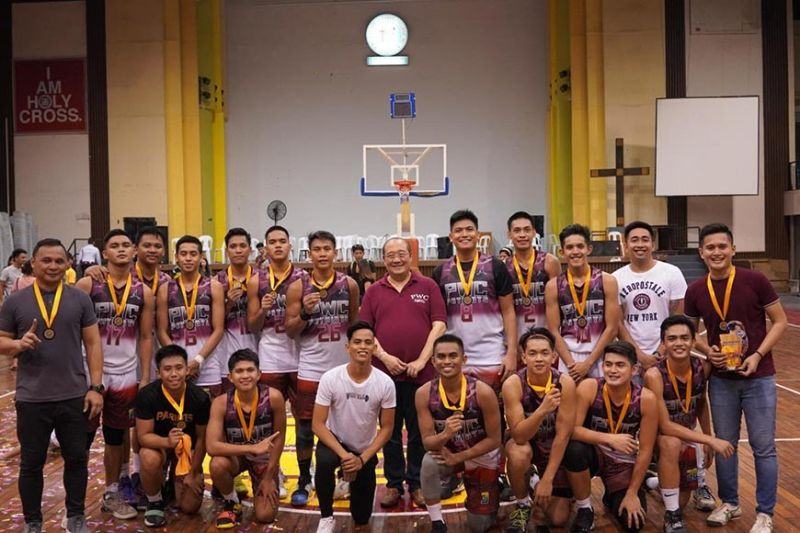 DAVAO. The Philippine Women's College Patriots players and coaches receive the gold medal after toppling Cor Jesu College of Digos, 95-84, in the rubber match of their best-of-three finals held Sunday, October 6, at Holy Cross of Davao College Gym, Sta. Ana Avenue, Davao City. (Robert Jagape Borinaga)