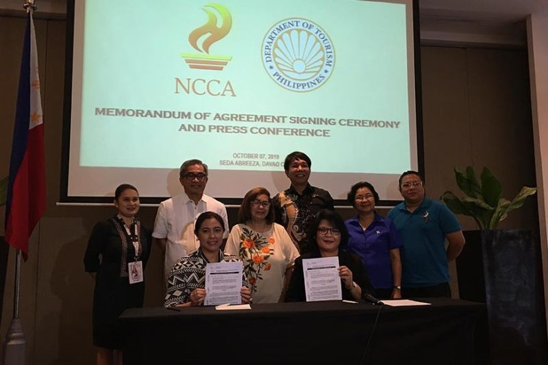 DAVAO. NCCA deputy executive director Marichu Tellano and DOT-Davao Director Tanya Rabat-Tan show to the media the signed memorandum of agreement for the P10-million grant of the NCCA for the development of the arts and culture hub in Davao Region. (Roberto A. Gumba Jr.)