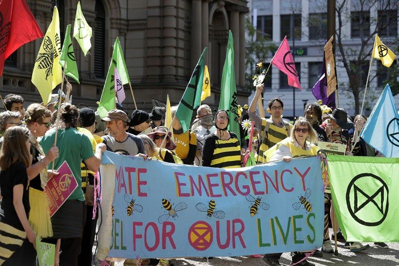 AUSTRALIA. Climate change protestors from the Extinction Rebellion movement gather to demonstrate at Town Hall in Sydney, Tuesday, October 8, 2019. In a series of protests also including Australian cities of Melbourne, Brisbane, and Perth, protestors are demanding much more urgent action against climate change. (AP)