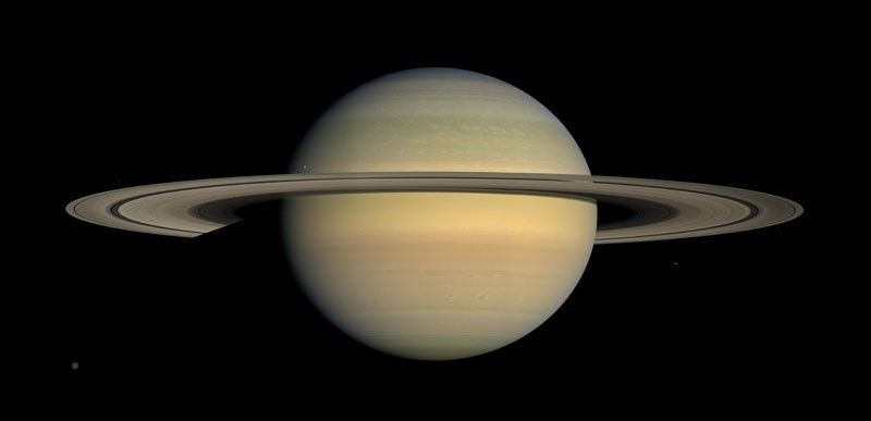 NASA. This July 23, 2008 file image made available by NASA shows the planet Saturn, as seen from the Cassini spacecraft. Twenty new moons have been found around Saturn, giving the ringed planet a total of 82, scientists said Monday, October 7, 2019. (AP)