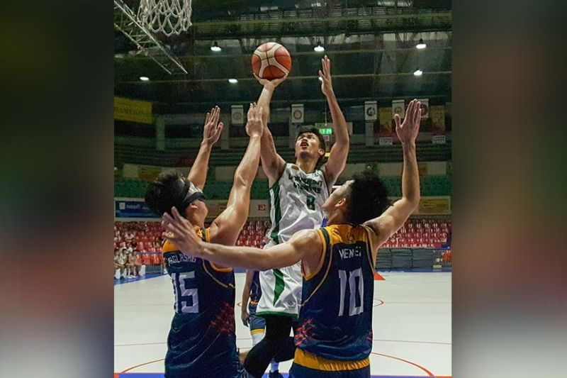 CEBU. Monic Soliva goes hard to the rack for two of his 10 points. (Arni Aclao)