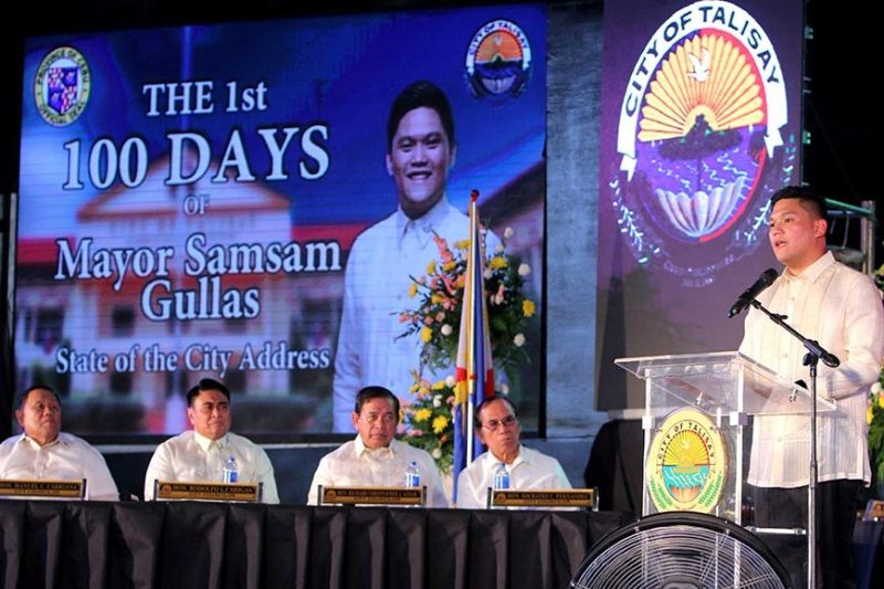 DEEDS. Talisay City Mayor Gerard Anthony Gullas Jr. (standing) delivers his accomplishment report in his first 100 days in office and his plans during his State of the City Address. (SunStar photo / Alex Badayos)