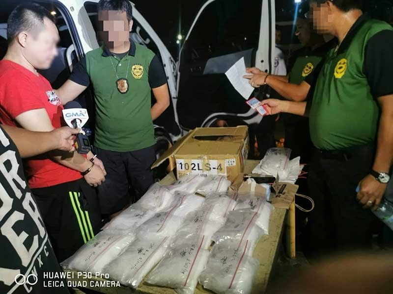 MANILA.. A Chinese national is collared in Quezon City after he was found in possession of around 15 kilos of shabu worth P102 million on October 8, 2019. (PDEA Photo)