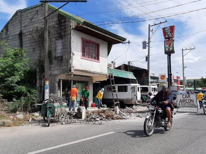 PAMPANGA. A portion of a pharmacy in Barangay Sampaloc, Apalit is demolished in compliance to Department of the Interior and Local Government Memorandum Circular 2019-121. (Princess Clea Arcellaz)