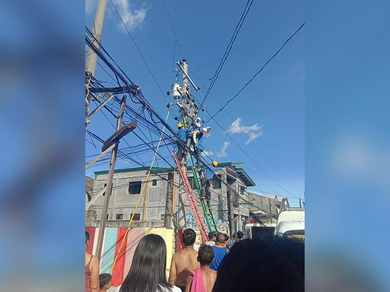 PAMPANGA. Pelco-3 linemen rescue a fellow lineman on Tuesday, October 8, 2019, after he was electrocuted while reconnecting power lines. (Contributed photo)