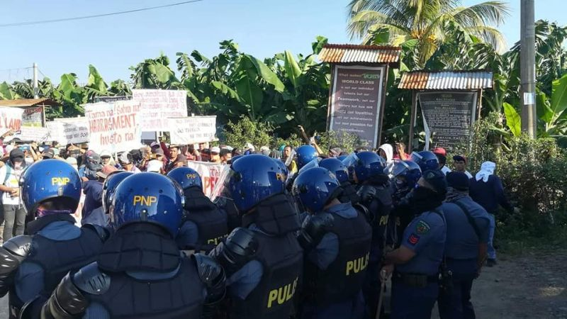 DAVAO. Tadeco workers try to stop the road clearing operations Wednesday, October 9, 2019, at the Tadeco plantation in Tanglaw, Braulio E. Dujali, Davao del Norte. (Tadeco Ko Bai photo)
