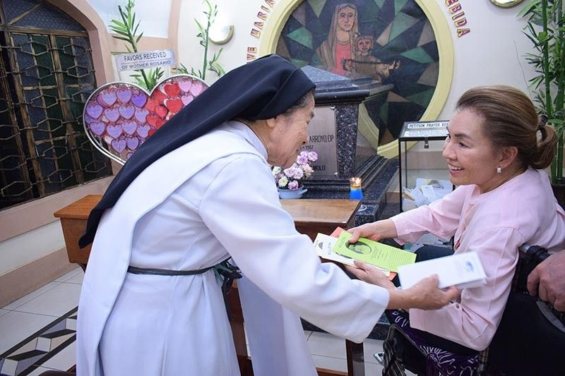 A nun welcomed Rep. Arroyo during her visit.