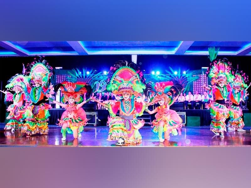 BACOLOD. Bacolod's MassKara dancers perform at the opening ceremony of the 19th National PESO (Public Employment Service Office) Congress at the SMX Convention Center Bacolod October 9. The congress runs until Oct. 11. (City PIO)