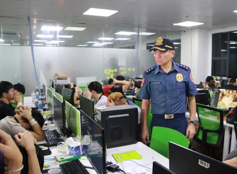 MANILA. National Capital Region Police Office Director Guillermo Eleazar takes part in a raid on a business process outsourcing (BPO) firm that led to the arrest of 542 illegal foreign workers, shown here with their hands clasped around their heads. (Photo from NCRPO)