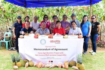 """BAGUIO. (From left) Ones Almario, Apo Agua general manager; Lyndon Cayog, Afamulco chairman; Maribeth L. Marasigan, Aboitiz Foundation chief operating officer; and Fermin Edillon, Davao Light community relations manager at the signing of a memorandum of agreement granting Afamulco  members training on correct cacao farming methodologies, financing, and market linkage group. This is the Aboitiz Group's first """"Integrated CSR"""" initiative in Mindanao, calling for a collective approach to achieving a more sustainable and inclusive impact. (Contributed Photo)"""