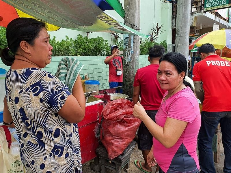 LOSS OF LIVELIHOOD. Vendors on Sanciangko St. at the back of the University of Visayas in Cebu City are forced to pack up as Probe personnel continue with clearing operations. (Sunstar Photo / Arni Aclao)