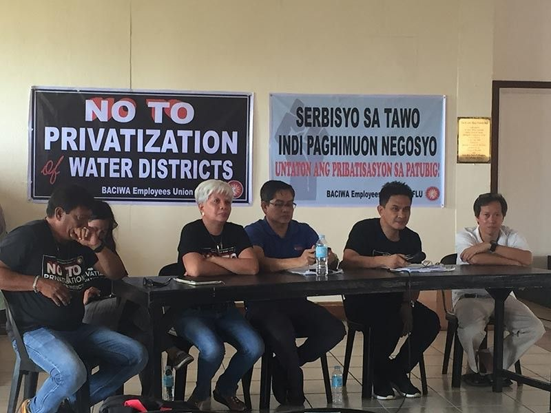 BACOLOD. Bayan Muna party-list Representative Ferdinand Gaite (third from right) along with the city officials and members of Amlig Tubig hold public consultation on the proposed privatization of Baciwa at St. John Marie Vianny Hall, San Sebastian Pastoral Complex in Bacolod City Thursday, October 10, 2019. (Merlinda A. Pedrosa)