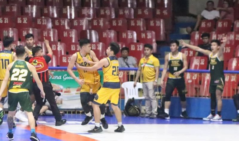 CEBU. University of Southern Philippines Foundation's Steven Ursal, seen here being held on to by his teammate Neon Chavez., is being accused by University of San Carlos's Kenneth Brillo (far right) of allegedly starting the brawl during a loose ball scramble with just 2.5 seconds remaining in their game on Thursday, October 10, 2019. (Amper Campaña)