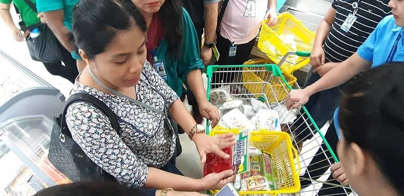 PROHIBITED. Dr. May Ann Gabona, head of the enforcement group of the African swine fever task force, shows pork products removed from shelves and freezers of grocery stores in Cebu. (Capitol PIO Photo)
