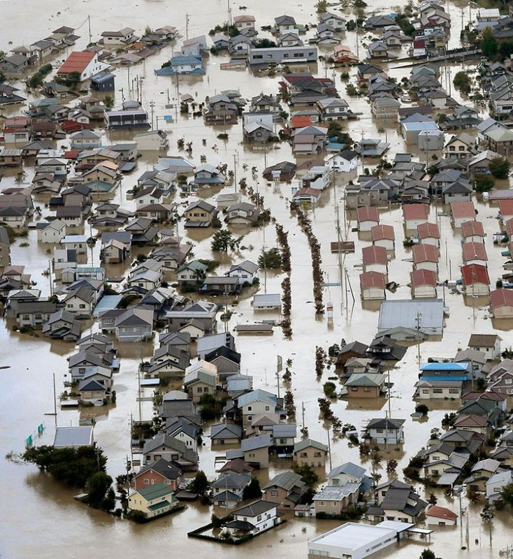 JAPAN. Residential area is seen in muddy waters after an embankment of the Chikuma River broke because of Typhoon Hagibis, in Nagano, central Japan, Sunday, October 13, 2019. (AP)