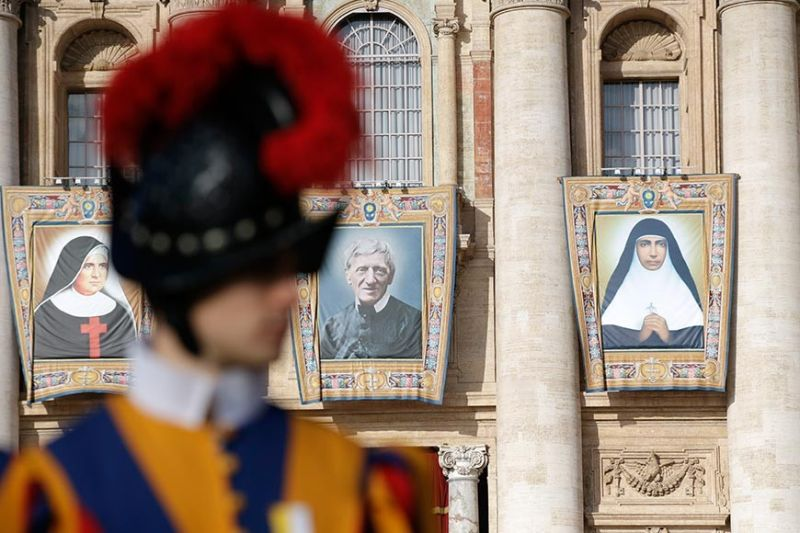 VATICAN CITY. Tapestries hanging from the facade of St. Peter's Basilica portray from left, Giuseppina Vannini, John Henry Newman and Maria Teresa Chiramel Mankidiyan, in St. Peter's Square at the Vatican, Sunday, October 13, 2019. Pope Francis canonizes Cardinal John Henry Newman, the 19th century Anglican convert who became an immensely influential thinker in both Anglican and Catholic churches, and four other women. (AP)