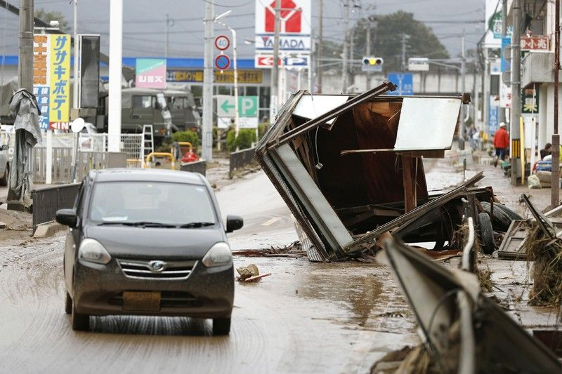 JAPAN. Debris caused by Typhoon Hagibis are left on a street in Motomiya, Fukushima prefecture, Japan Monday, October 14, 2019. Rescue crew dug through mudslides and searched near flooded rivers for missing people Monday after the typhoon caused serious damage in central and northern Japan. (AP)