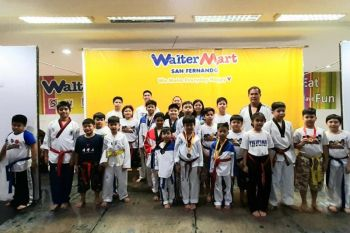 PAMPANGA. Representatives of the Pampanga team who bagged different medals during the recently concluded Regional Taekwondo Championship in posterity with their trainer Coach Dauphin Punzalan. (Photo by Princess Clea Arcellaz)