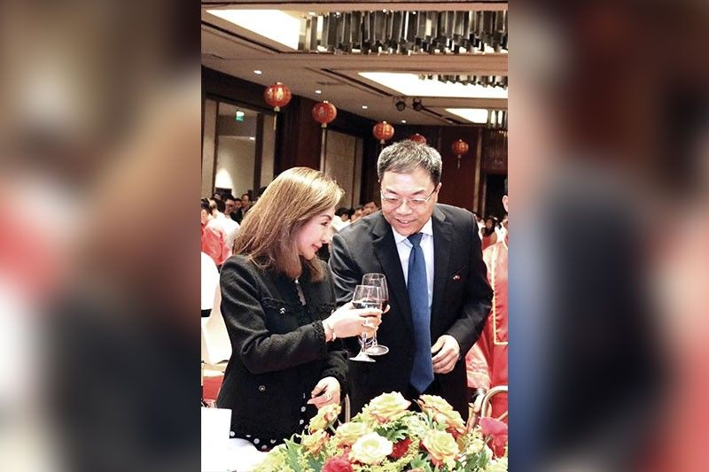 A TOAST TO FRIENDSHIP. Consul General Jia Li (right) of the People's Republic of China (PROC) and Cebu Gov. Gwen Garcia during the formal reception at the Grand Ballroom of Marco Polo Plaza Cebu, in celebration of the 70th Founding Anniversary of PROC.