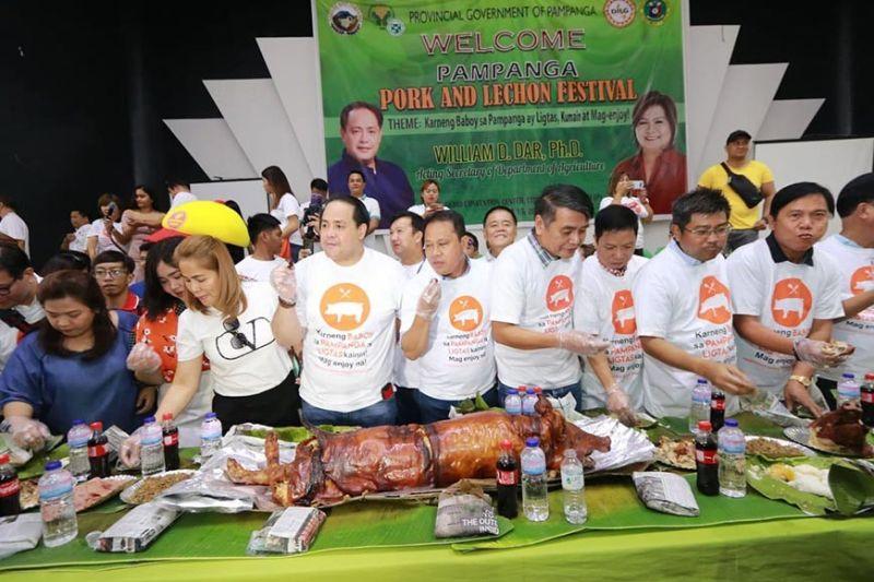 PAMPANGA. Pampanga officials led by Governor Dennis Pineda feast on lechon and other pork products on Tuesday, October 15, 2019, to allay fears of swine flu in Pampanga. (Chris Navarro)