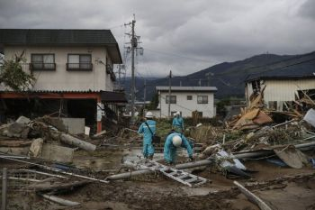 JAPAN. Utility workers survey damages in a neighborhood devastated by Typhoon Hagibis Tuesday, October 15, 2019, in Nagano, Japan. More victims and more damage have been found in typhoon-hit areas of central and northern Japan, where rescue crews are searching for people still missing. (AP)