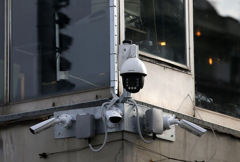 SERBIA. In this photo taken September 25, 2019, high-tech video cameras hang from an office building in downtown Belgrade, Serbia. The cameras, equipped with facial recognition technology, are being rolled out across hundreds of cities around the world, particularly in poorer countries with weak track records on human rights where Beijing has increased its influence through big business deals. (AP)