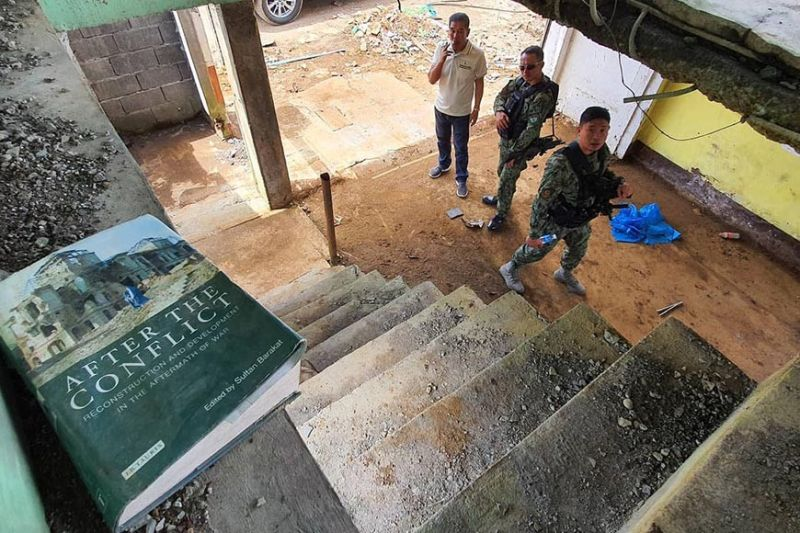 A book about the aftermath of Marawi siege lies at the stairway of a destroyed house in the city's ground zero. Task Force Bangon Marawi on Wednesday continues to show the ongoing rehabilitation efforts of the government amid criticisms of slow-pace rebuilding works, two years since the city was