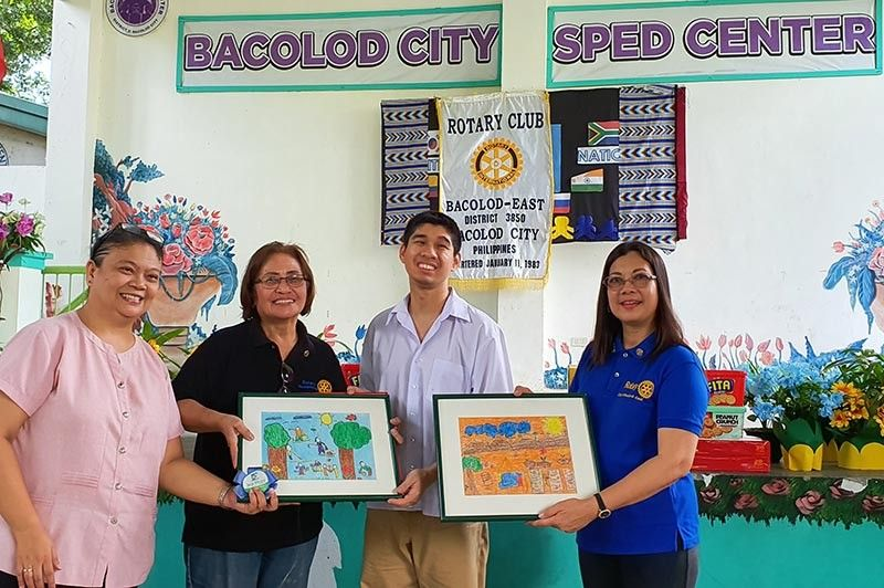 BACOLOD. Teacher leader Ella Dapiton, (L-R) with Rotary Club of Bacolod East Vice President Elsie Jolingan and RI District 3850 Past District Secretary Sonya M. Verdeflor (extreme right) showing the artworks made by this youngster schooled at Special Education (SPED) Center. (Contributed photo)