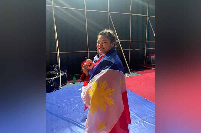 BRONZE FINISH. Sydney Sy Tancontian shows her bronze medal won in the recently-concluded World Youth and Juniors Sambo Championships 2019 at the Sports Complex Uzbekistan recently. (Contributed photo)