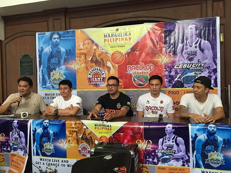 Bacolod City Lone District Representative Greg Gasataya (left) along with Bacolod Master Sardines team headed by its coach Vic Ycasiano (2nd from left) during the press conference at the University of St. La Salle (USLS) in Bacolod City Tuesday afternoon. (Merlinda A. Pedrosa)