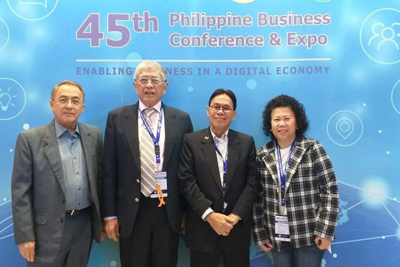 (From left) Metro Bacolod Chamber of Commerce and Industry chief executive officer Frank Carbon and president Roberto Montelibano with Central Negros Electric Cooperative president Dwight Carbon and Bacolod City Water District general manager Atty. Juliana Carbon, also the chamber's secretary, at the ongoing 45th Philippine Business Conference and Expo at The Manila Hotel in Manila City yesterday.