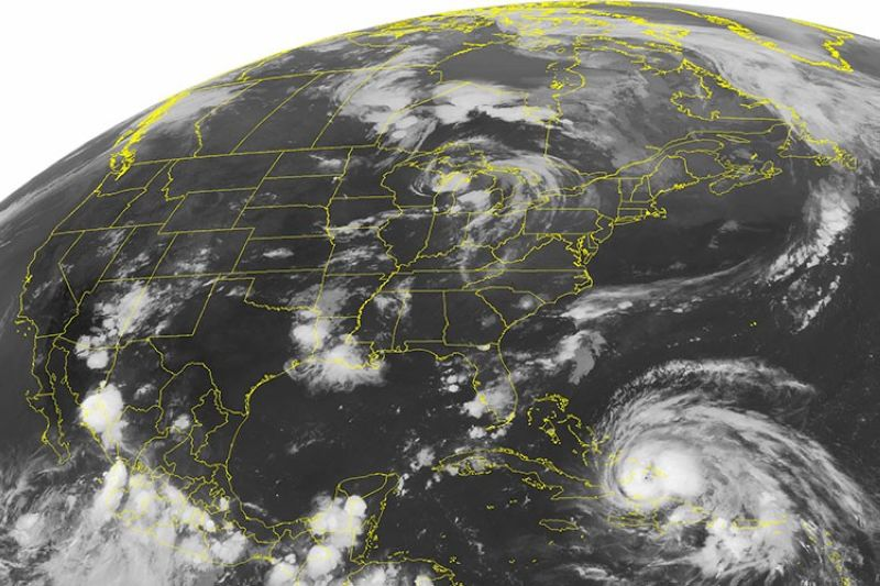 """USA. This Wednesday, August 24, 2011, NOAA satellite image shows Hurricane Irene, a category 2 storm with winds up to 100 mph and located about 400 miles southeast of Nassau. According to a study published Monday, October 14, 2019 in the journal Geophysical Research Letters, scientists have discovered a real life mash-up of two feared disasters -- hurricanes and earthquakes -- called """"stormquakes."""" (AP)"""