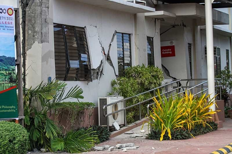 DAVAO. Damaged walls are seen on a building a day after a strong quake struck in Digos, Davao del Sur province Thursday, Oct. 17, 2019. A powerful and shallow earthquake hit several southern Philippine provinces Wednesday night injuring some people in collapsed houses and prompting thousands to scramble out of homes, shopping malls and a hospital in panic, officials and news reports said. (AP Photo)