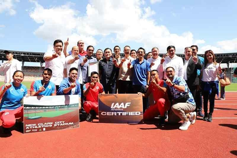 PAMPANGA. Senator Christopher Go (standing fourth from left) and House Speaker Alan Peter Cayetano pose with athletes at the IAAF-certified New Clark City Athletics Stadium. With them are other members of the House Committee on Youth and Sports Development. (Contributed photo)
