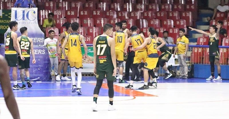CEBU. Players from the University of San Carlos and the University of Southern Philippines Foundation get physical with only two seconds left. (Amper Campana)