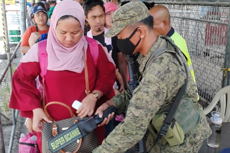 ZAMBOANGA. A soldier assigned with the Task Force Zamboanga conducts thorough inspection Friday, October 18, of all inbound passengers at the port of Zamboanga as security has been tightened amid threats from lawless groups, including the Abu Sayyaf. (SunStar Zamboanga)