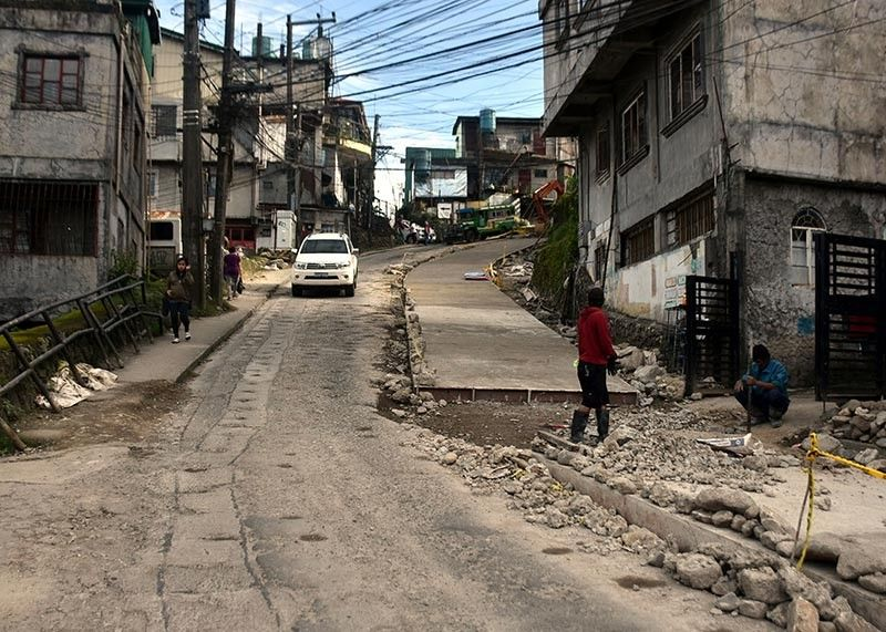 BAGUIO. Residents along Honeymoon and Holy Ghost Extension are appealing to the contractor of the ongoing road and drainage project to provide flag men who will man the traffic for 24 hours to ensure safety of motorists and pedestrians. (Redjie Melvic Cawis)