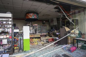 Debris are scattered on the floor of a damaged store a day after a strong quake struck in Digos, Davao del Sur province, southern Philippines Thursday, Oct. 17, 2019. A powerful and shallow earthquake hit several southern Philippine provinces Wednesday night injuring some people in collapsed houses and prompting thousands to scramble out of homes, shopping malls and a hospital in panic, officials and news reports said. <b>(AP Photo)</b>