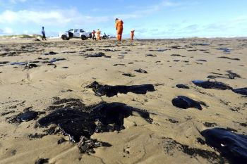 BRAZIL. In this October 7, 2019 handout photo released by the Aracaju Municipal Press Office, workers remove oil from Viral Beach, in Aracaju, Brazil. The oil that has been polluting Brazil's northeastern beaches since early September is likely coming from Venezuela, according to a report by Brazil's state oil company cited by the country's environment minister. The oil sludge has now reached 61 municipalities in nine Brazilian states, contaminating over 130 beaches, in what Brazilian officials have called an