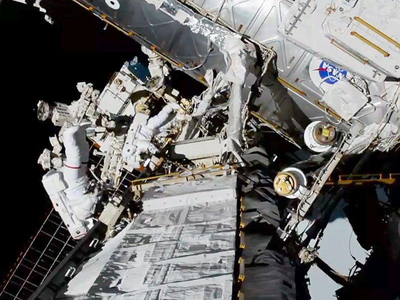 INTERNATIONAL SPACE STATION. In this photo provided by NASA astronauts Christina Koch and Jessica Meir exits the International Space Station on Friday, October 18, 2019. The world's first female spacewalking team is making history high above Earth. This is the first time in a half-century of spacewalking that a woman floated out without a male crewmate. Their job is to fix a broken part of the station's solar power network. (AP)
