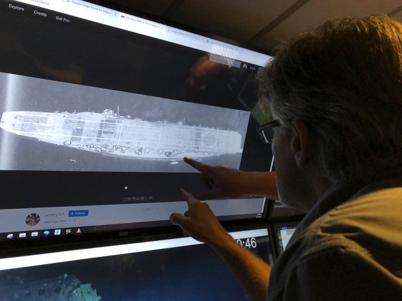 MIDWAY ATOLL. In this Wednesday, October 16, 2019, photo, Vulcan Inc. director of subsea operations of the Petrel, Rob Kraft looks at images of the Japanese aircraft carrier Kaga, off Midway Atoll in the Northwestern Hawaiian Islands. Deep-sea explorers scouring the world's oceans for sunken World War II ships are honing in on a debris field deep in the Pacific. The research vessel called the Petrel is launching underwater robots about halfway between the U.S. and Japan in search of warships from the Battle of Midway. (AP)