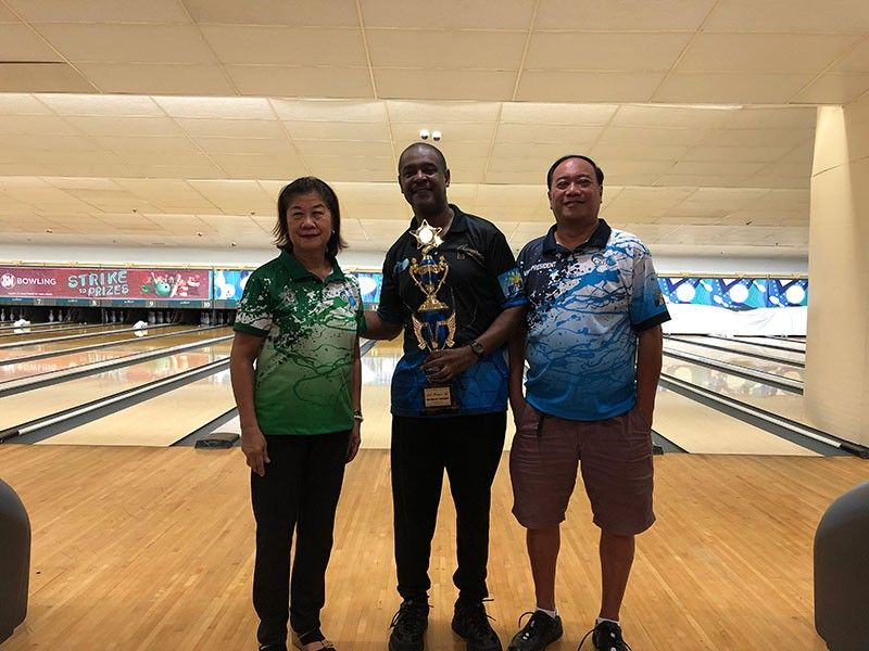 FINAL QUALIFIER. Terence Williams (center) receives his trophy after topping the monthly qualifiers with 1,104 pinfalls. (Contributed Photo)