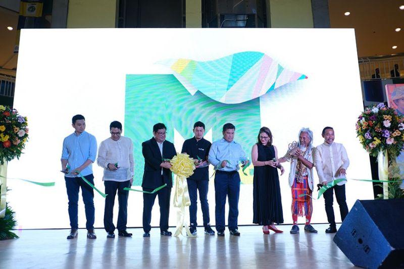 "DAVAO. It's open. From left are Gaisano Mall of Davao's Kelvin Gaisano, National Committee on Art Galleries head John Delan Robillos, NCCA commissioner for Cultural Heritage Section Fr. Harold Rentorias, Vice Mayor Sebastian Duterte, NCCA executive director Al Ryan Alejandre, Hijos Resources CEO Rosanna Tuason-Fores, national artist for film Rene ""Kidlat Tahimik"" de Guia, and MindanaoArt organizer Kublai Millan. (Mindanao Art Photo)"