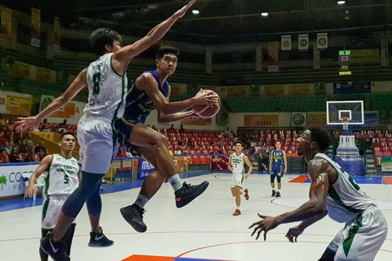 UC's John Jabello hangs in the air for a lay-up. (Arni Aclao)