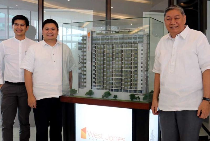 NEW HOME. Allen Andre Suarez (left), marketing director at Vibo Land Corp., together with Ian Martin Borromeo (center), construction management head of Vibo Land Corp., and Gerardo Borromeo (left), president of Vibo Land Corp.,  unveil the company's first condominium project—West Jones Residences located on Uytengsu St., Sambag II, Cebu City. (SUNSTAR FOTO / AMPER CAMPAÑA)