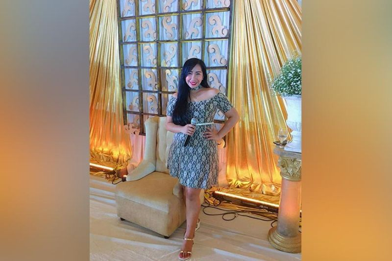 Events organizer and host Lizza Taton-Bentinganan at one of the weddings she organized.