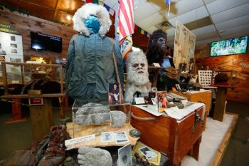 GEORGIA. This August 8, 2019, photo shows items donated by the family of Yeti researcher Tom Slick on display at Expedition: Bigfoot! The Sasquatch Museum in Cherry Log, Georgia. The owner of this intriguing piece of Americana at the southern edge of the Appalachians is David Bakara, a longtime member of the Bigfoot Field Researchers Organization who served in the Navy, drove long-haul trucks and tended bar before opening the museum in early 2016 with his wife, Malinda. (AP)
