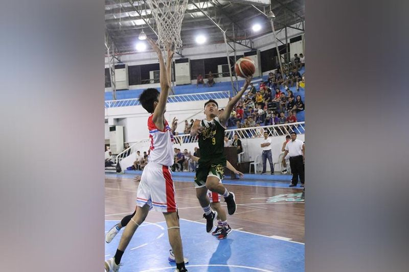 DAVAO. An Agro-Industrial Foundation College of the Philippines Sailors player shoots against a Holy Cross of Davao College Crusaders defender during their 2019 Collegiate Sponsors League Escandor Cup game at the Almendras Gym Davao City Recreation Center Saturday, October 19, 2019. (Mark Perandos)