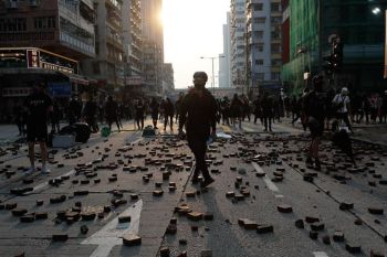 HONG KONG. Protestors stand on scattered bricks as they clash with police in Hong Kong, Sunday, October 20, 2019. Hong Kong protesters again flooded streets on Sunday, October 20, ignoring a police ban on the rally and setting up barricades amid tear gas and firebombs. (AP)